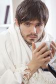 Sick man with tea — Stock Photo