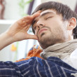 Sick man with headache — Stock Photo