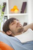 Man with book sleeping — Stock Photo