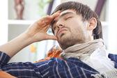 Sick man with headache — Stock Photo