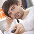 Man with remote — Stock Photo