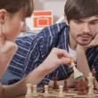 Couple playing chess game — Stock Photo #4562210