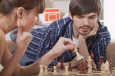 Couple playing chess game — Foto de Stock