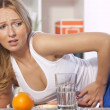Woman with stomach pain - Stock Photo