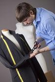 Tailor working on jacket — Stock Photo