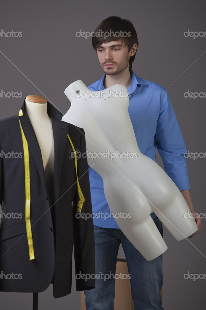 Young fashion tailor with a mannequin — Stock Photo #4855530