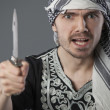 Angry arabic man with knife — Stock Photo