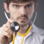 Doctor using stethoscope — Stock Photo #4992401