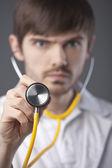 Doctor using stethoscope — Stock Photo