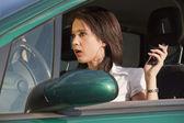 Surprised female in car — Stock Photo