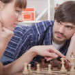 Couple playing chess — Stock Photo #5143584
