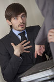 Stressed man by paperwork — Stock Photo