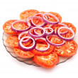 Sliced tomatoes and red onion — Stock Photo