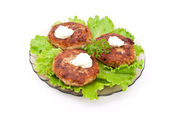 Cutlets with salad leaves — Stock Photo