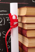 Chalkboard with a diploma and books — Stock Photo