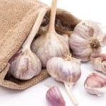 Burlap sack with garlic — Stock Photo #4411009