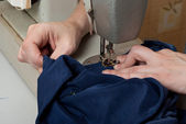 Work on the sewing machine — Stock Photo