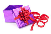 Open gift box with red bow — Stock Photo