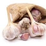 Burlap sack with garlic — Stock Photo #4666886