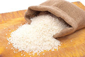 White rice in small burlap sack — Stock Photo