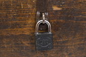 Padlock on old wooden coffer — Stock Photo