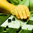 Hands of a dj adjusting the crossfader — Stock Photo