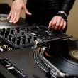 Female rnb deejay playing turntables — Stock Photo #3935145