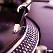 Stock Photo: Vinyl record player spinning disc