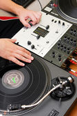Hip-hop DJ scratching the vinyl record — Stock Photo