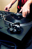 Hip-hop dj scratching the vinyl — Stock Photo