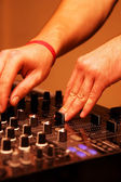DJ adjusting music level — Stock Photo