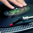 DJ scratching the vinyl record - Stock Photo