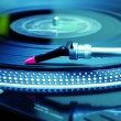 Turntable playing vinyl record - Stock Photo