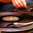 DJ playing music from turntable - Stock Photo