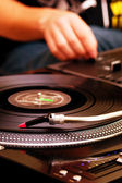 DJ playing music from turntable — Stock Photo