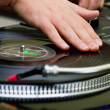 Hip-hop DJ scratching vinyl — Stock Photo #4123567