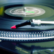 Turntable playing vinyl record — Stock Photo #4123570