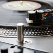 Turntable playing vinyl record with music — Stock Photo #4123601