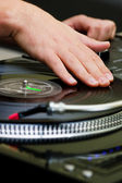 Hip-hop DJ scratching the vinyl — Stock Photo