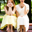 Artistic young girls in the park - Stock Photo