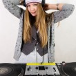 Female DJ at the turntables — Stock Photo