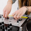 Royalty-Free Stock Photo: Female DJ adjusting sound level