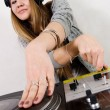 Female DJ scratching the record — Stock Photo #4300697