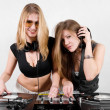 Stock Photo: Female Djs mixing vinyl