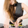 Stock Photo: Female DJ adjusting sound levels