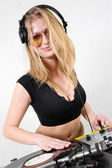 Female DJ scratching the record — Stock Photo
