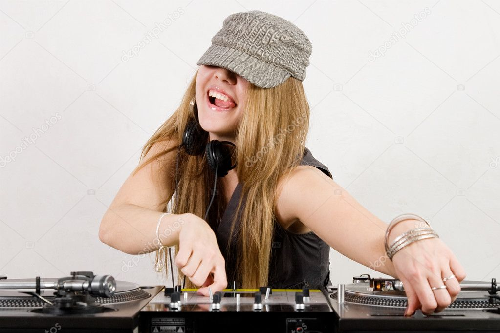 Funny blond girl with beautiful long hair playing music — Stock Photo #4301190