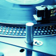 Turntable playing vinyl record with music — Stock Photo #4311034