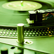 Turntable playing vinyl record with music - Stok fotoğraf