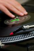 DJ scratching the vinyl record — Stock Photo